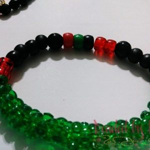 "King & Queen ""Red, black, green"" wrist bracelet."