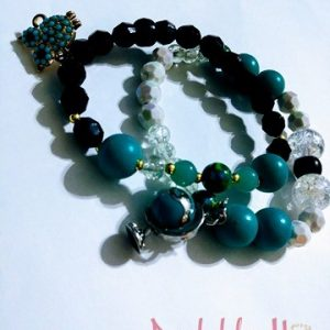 """Wisdom"" Wrist bracelets with ""Spinning globe charm"" and ""Paved Owl"" charm"