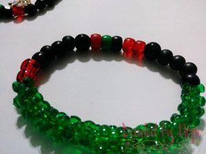 "King & Queen ""Red, black, green"" wrist bracelet."