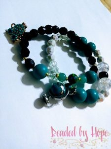 """Wisdom"" Wrist bracelets with ""Spinning globe charm"" and ""Paved Owl"" charm"